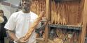 Djibril Bodian, 33 ans, d'origine sénégalaise, boulanger salarié dans le XVIIIème arrondissement de Paris au 'Grenier à pain', et lauréat 2010 du grand prix de la baguette de la ville de Paris pose avec son pain le 25 mars 2010. Pas moins de 163 candidats ont apporté le 23 mars 2010 deux baguettes c