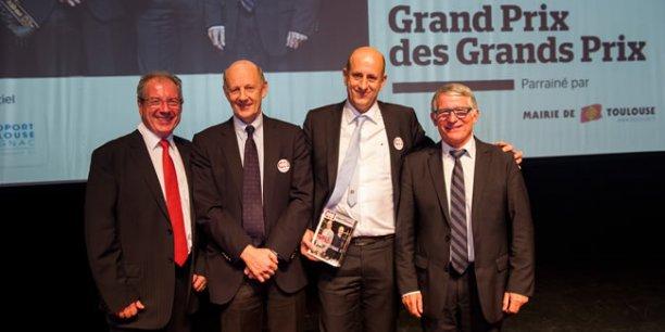 Philippe et Pierre-Georges Chausson, dirigeants de Chausson Matériaux, ont reçu le Grand Prix des Grands Prix 2013 Objectif News des mains de Jean-Michel Vernhes (Aéroport Toulouse-Blagnac) et Pierre Cohen (Mairie de Toulouse)