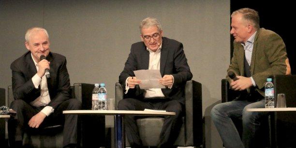 François Pérol, président du directoire de BPCE, à gauche, et Matthias Kröner, directeur général de Fidor, à droite, au Paris Fintech Forum, ce mercredi au Palais Brongniart.