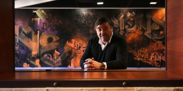 Michel Réglat, le plus important franchisé McDonald's de France, dans son restaurant près de la place Wilson.