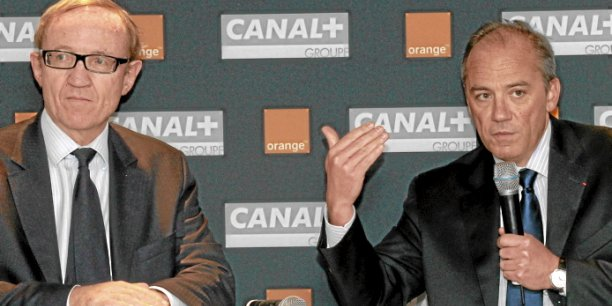 Bertrand Méheut (Canal Plus) et Stéphane Richard (Orange) Copyright Reuters