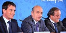 Alain Juppé, lors de conférence de presse de présentation de l'Euro 2016, en octobre 2014, aux côtés du Premier ministre Manuel Valls et Michel Platini, encore président de l'UEFA