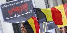 Membres de la communauté musulmane belge lors de la cérémonie, le 9 avril à Bruxelles, en hommage aux victimes des attaques terroristes perpétrées le 22 mars dans le métro et à l'aéroport de Zaventem.