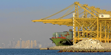 The container ship Xin Yan Tian, owned by China Shipping Container Lines Co. Ltd., sits at Jebel Ali Port, with the skyline of the city of Dubai, United Arab Emirates in the background, on Wednesday, Dec. 26, 2007. Jebel Ali Port, owned by DP World Ltd., the fourth-biggest port operator, is the larg
