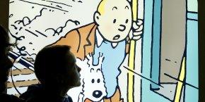 Dans la planche vendue samedi, Tintin et son chien Milou sont représentés dans 34 situations différentes, chacune rattachée à un moment fort d'un album. (Photo: Reuters)