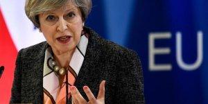 Theresa may dit que le moment est venu d'enclencher le brexit