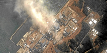 The No.3 nuclear reactor of the Fukushima Daiichi nuclear plant is seen burning after a blast following an earthquake and tsunami in this handout satellite image taken March 14, 2011. The Fukushima nuclear complex, 240 km (150 miles) north of Tokyo, has already seen explosions at two of its reactors