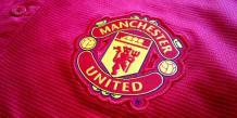 Le logo du célèbre club de football britannique Manchester United.