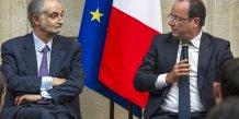 Jacques Attali aux côtés du président de la République Français Hollande à l'Élysée en septembre 2013