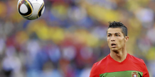 Portugal's striker Cristiano Ronaldo eyes the ball during the Group G first round 2010 World Cup football match Portugal vs. Brazil on June 25, 2010 at Moses Mabhida stadium in Durban. NO PUSH TO MOBILE / MOBILE USE SOLELY WITHIN EDITORIAL ARTICLE  --     AFP PHOTO / FABRICE COFFRINI