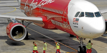 An AirAsia Bhd. airplane from Kuala Lumpur, Malaysia, lands at Changi Airport on its inaugural flight to Singapore, on Friday, Feb. 1, 2008. It was AirAsia's first Kuala Lumpur to Singapore flight. Photographer: Munshi Ahmed/Bloomberg News