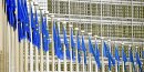 A row of European Union flags fly outside the EU Commission building in Brussels, Belgium, on Monday, Feb. 15, 2010. European finance ministers are under pressure from investors to spell out the concrete measures they will take to rescue Greece, as new evidence emerged that the country may have turn