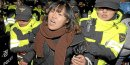 A protester is detained by police officers as she tries to march toward the presidential Blue House during a rally against the South Korea-U.S. Free Trade Agreement (FTA) talks in central Seoul November 26, 2011. South Korea's ruling conservatives rammed a controversial free trade deal with the Unit