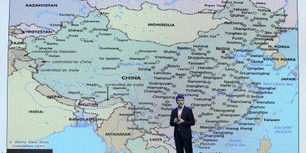 Le fondateur et CEO d'Uber Travis Kalanick présente le plan d'Uber pour la Chine en septembre 2015 lors d'une conférence avec son partenaire Baidu à Pékin
