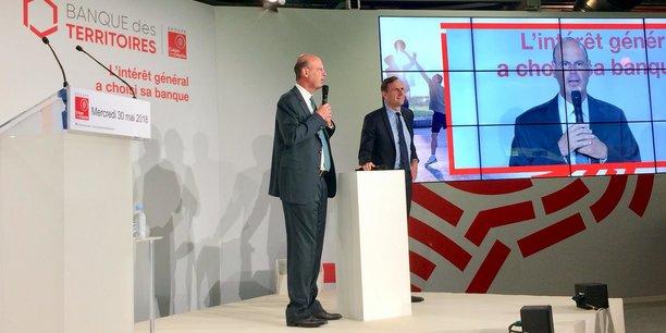 Éric Lombard (à gauche), le directeur général de la Caisse des dépôts lors du lancement national de la Banque des territoires en mai, en compagnie d'Olivier Sichel.