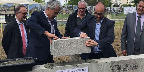 La pose de la première pierre de l'îlot Sud de Coeur Thouars