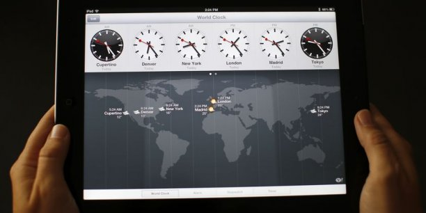 L'application horloge sur iPad qui reprend le graphisme des horloges des gares suisses. Copyright Reuters