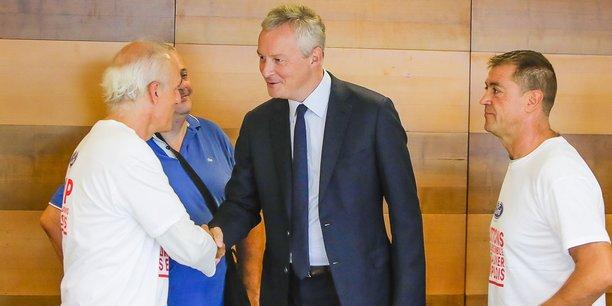 La bonne entente entre Philippe Poutou (à gauche), le ministre Bruno Le Maire, au centre, et Gilles Lambersend, à droite, secrétaire du CE de FAI, semble mal en point.