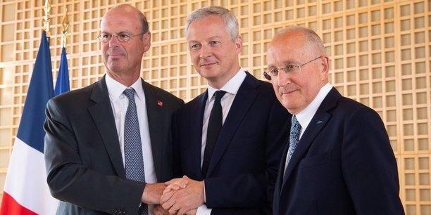 Le directeur général de la Caisse des Dépôts, Eric Lombard, le ministre de l'Economie et des Finances Bruno Le Maire et le Pdg de La Poste Philippe Wahl.
