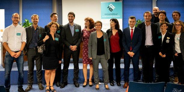 Mélanie Parnot, aux côtés de l'équipe et des partenaires de l'IdBM