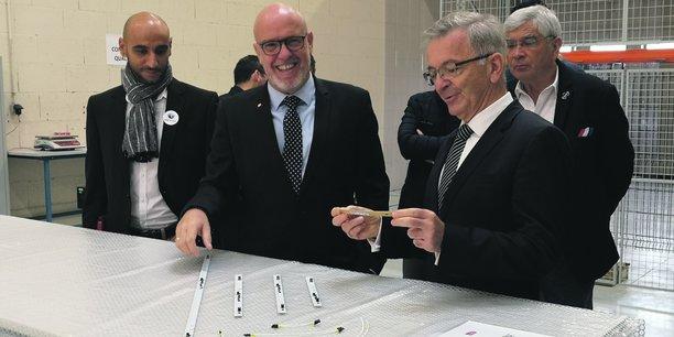 Charles Nadal (au centre), dirigeant de la filiale française de TDG.