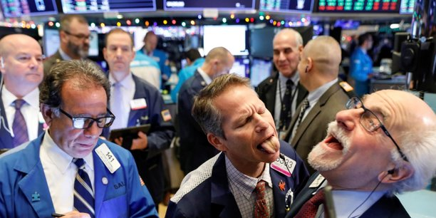 Des traders sur le parquet du New York Stock Exchange en décembre 2019.