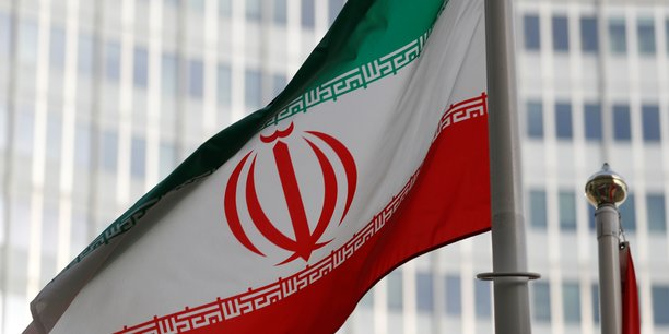 The iranian flag flutters in front the international atomic energy agency (iaea) headquarters in vienna[reuters.com]