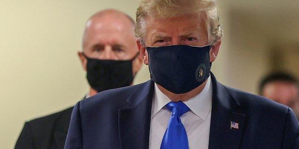Usa: trump muni d'un masque en public pour la premiere fois[reuters.com]