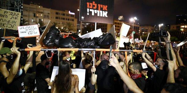 Israel: manifestations contre la reponse gouvernementale au coronavirus[reuters.com]