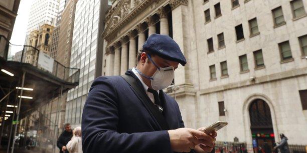 Le Dow Jones franchit pour la première fois la barre des 30.000 points à Wall Street