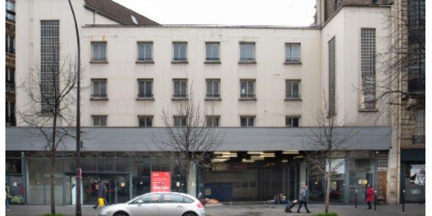 Cet ancien garage Citroën PSA de 6.500 m² situé 62, avenue de la République (Paris XIè), devrait accueillir, à terme, au moins 60% de logements sociaux et 20% de logements libres.