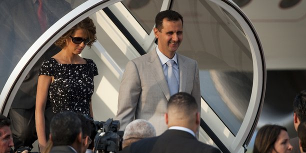 Syria's president assad and his wife asma disembark from a plane as they arrive for an official visit in caracas[reuters.com]
