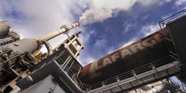La nouvelle entité née de la fusion entre Lafarge et Holcim devrait sièger en Suisse. (Photo : Reuters)