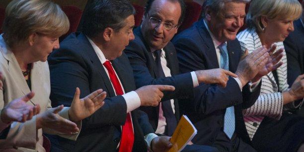 François Hollande aux 150 ans de la SPD allemande, avec Sigmar Gabriel et Angela Merkel