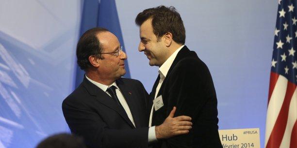 Carlos Diaz, leader du mouvement des pigeons a mis François Hollande au défi de l'étreindre, ce que le chef de l'Etat s'est empressé de faire. (Reuters/Robert Galbraith)