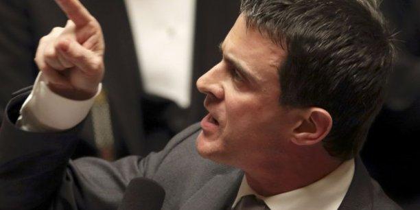 En Italie, les journaux comparent Manuel Valls au nouveau président du conseil italien, Mateo Renzi, pour son attitude directe. (Photo : Reuters)
