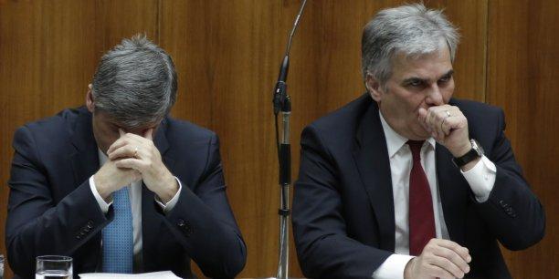 Le chancelier autrichien Werner Faymann et son ministre des Finances Michael Spindelegger tentent de sortir de la crise Hypo Alpe Adria