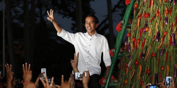 Le délai de proclamation des résultats officiels a été prolongé de deux semaines et a rendu son verdict mardi : Jokowi, considéré comme un candidat de rupture sans liens avec l'ère du dictateur Suharto (1967-1998), est déclaré vainqueur avec 53,15% des voix. (Photo : Reuters)