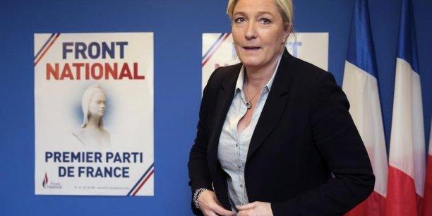 Capitalisant sur son succès aux élections européennes de mai dernier, Marine le Pen rassemblerait ainsi 26% des suffrages, devançant de peu Nicolas Sarkozy (25%) et distançant nettement François Hollande (17%) indique l'Ifop. (Photo: Reuters)