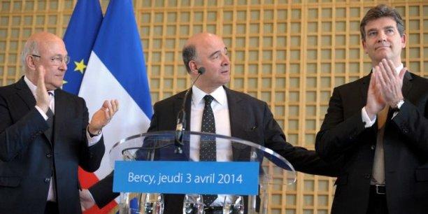 Passation de pouvoir, le 3 avril 2014, de Pierre Moscovici, ancien ministre de l'Economie et des Finances, à Michel Sapin, nouveau ministre des Finances et des Comptes publics et à Arnaud Montebourg, nouveau ministre de l'Economie, du Redressement productif et du Numérique.