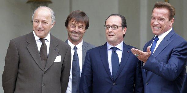 Arnold Schwarzenegger à l'Elysée en compagnie de François Hollande, Nicolas Hulot et de Laurent Fabius, à l'occasion du R20 sur le climat.