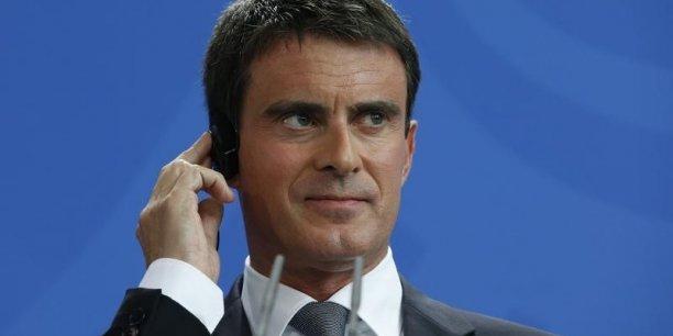 Plus de la moitié des salariés doivent être concernés par le pacte de responsabilité d'ici la fin de l'année, espère Manuel Valls, à contre-courant du ministre de l'Economie Emmanuel Macron qui s'avouait déçu la semaine dernière du nombre des accords.