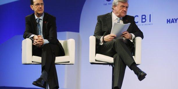 Le directeur de la CBI John Cridland et son président Michael Rake écoute le discours de David Cameron lors de la conférence de presse annuelle.