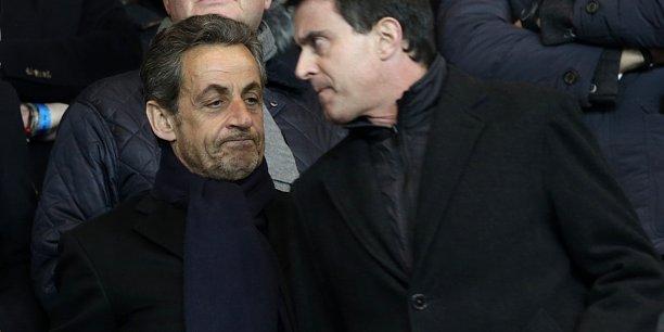 Manuel Valls et Nicolas Sarkozy (ici au Parc des Princes en mars 2014) bénéficient tous deux d'une réputation forte sur la question sécuritaire.