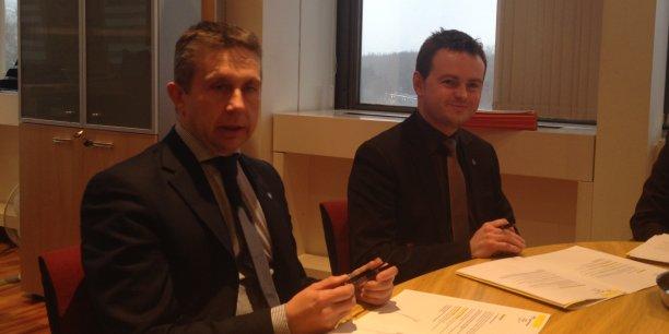 Le président de Grenoble Alpes Métropole, Christophe Ferrari (à gauche) et Raphaël Guerrero, vice-président en charge des finances (à droite).