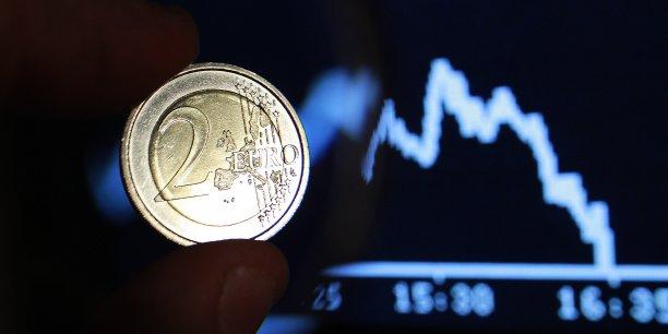 La devise atteint des planchers sous l'effet de la reprise aux Etats-Unis et du plan de quantitative easing de Mario Draghi.