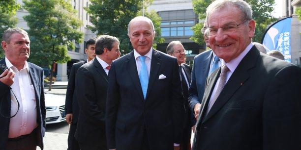 Daniel Gouffé, directeur d'Erai, ici aux côtés du ministre des Affaires étrangères, Laurent Fabius