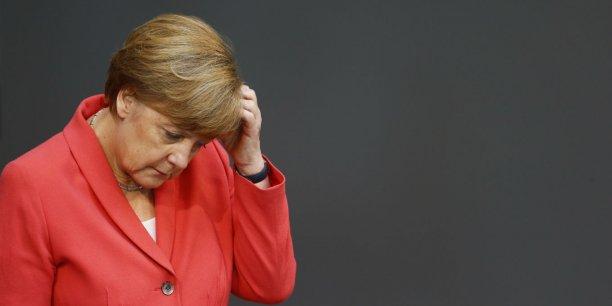 Dans le camp conservateur de la chancelière Angela Merkel, 60 députés avaient dit non aux négociations sur un troisième plan d'aide à la Grèce.