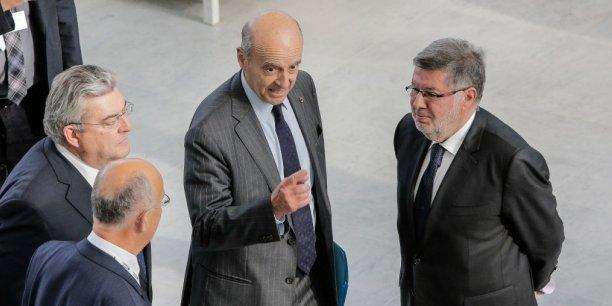Lors de l'inauguration d'ITS, hier, Alain Juppé en pleine intervention, entre le préfet Pierre Dartout, à gauche, et Alain Vidalies, secrétaire d'Etat chargé des Transports.