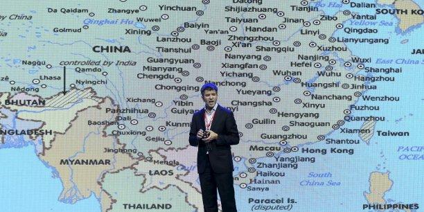 Travis Kalanick, le fondateur d'Uber, plateforme de mise en relation de passagers avec des voitures de transport avec chauffeurs (VTC), lors d'une présentation à Pékin en septembre.